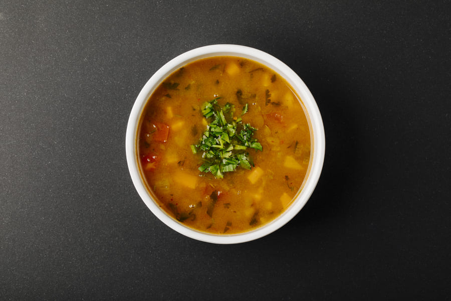 lentil-soup-with-mixed-ingredients-herbs-white-bowl (1).jpeg