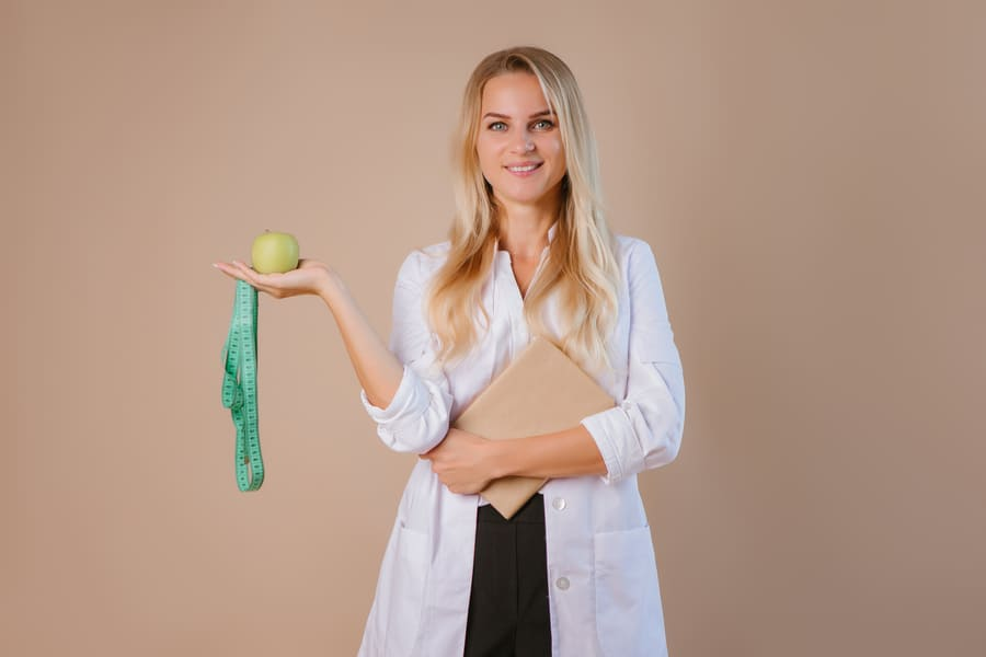 nutritionist-doctor-holds-centimeter-ribbon-concept-losing-weight-eating-healthy (1).jpeg