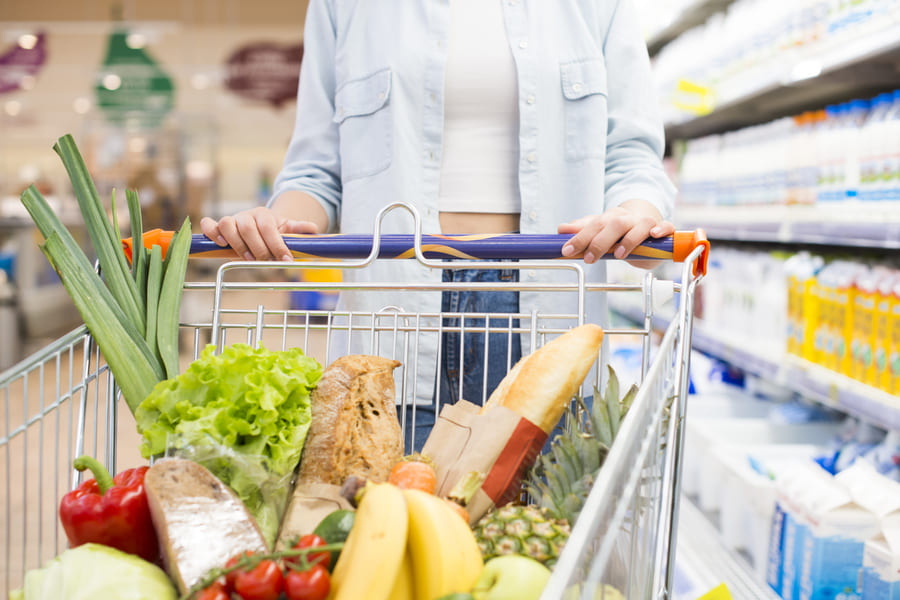 faceless-female-driving-shopping-cart-supermarket (1).jpeg