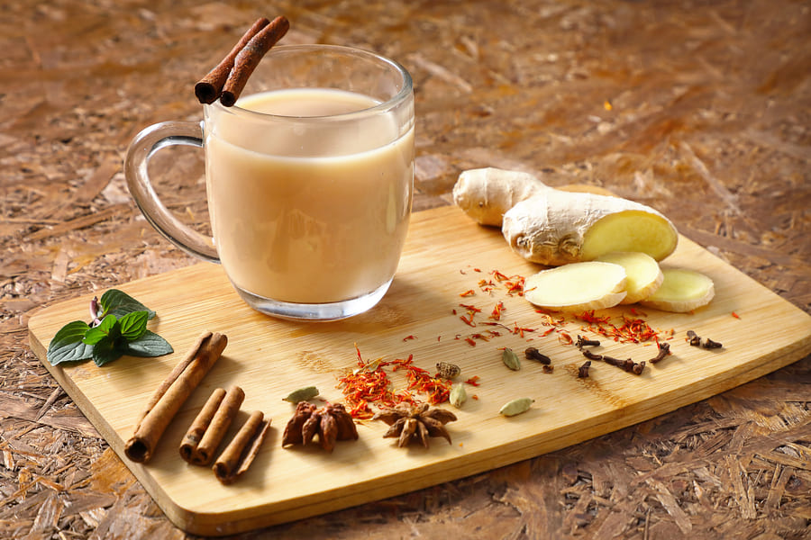 masala-tea-useful-tea-with-spices-indian-recipe-ingredients-board (1).jpeg