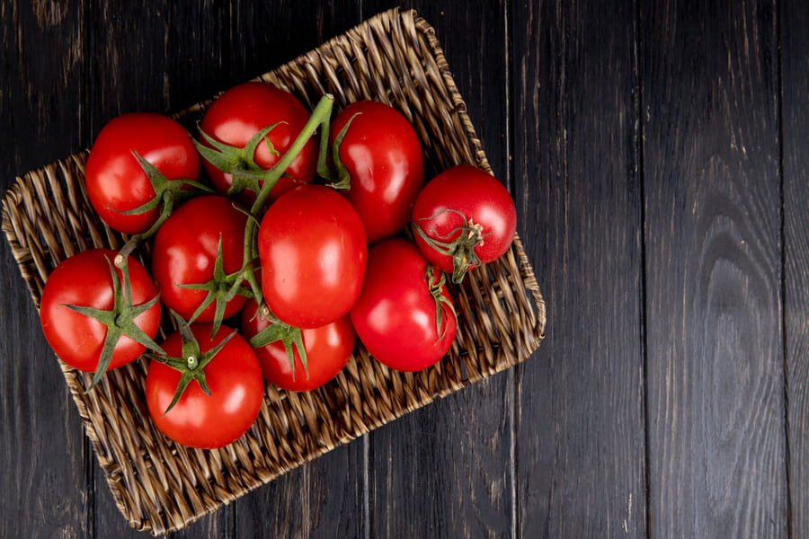 top-view-tomatoes-basket-plate-wood-with-copy-space (1).jpg